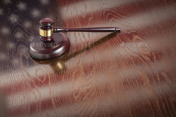 Wooden Gavel Resting on Flag Reflecting Table - Stock Photo - Images