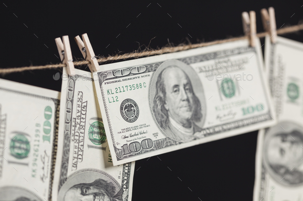 Hundred Dollar Bills Hanging From Clothesline on Dark Background - Stock Photo - Images