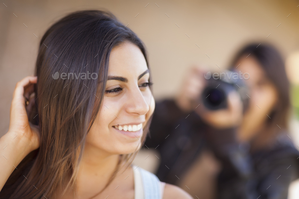 Young Adult Mixed Race Female Model Poses for Photographer - Stock Photo - Images