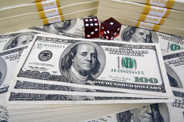 One Hundred Dollar Bills & Red Dice - Stock Photo - Images
