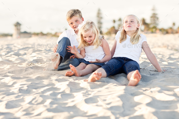 Adorable Sisters and Brother Having Fun at the Beach - Stock Photo - Images