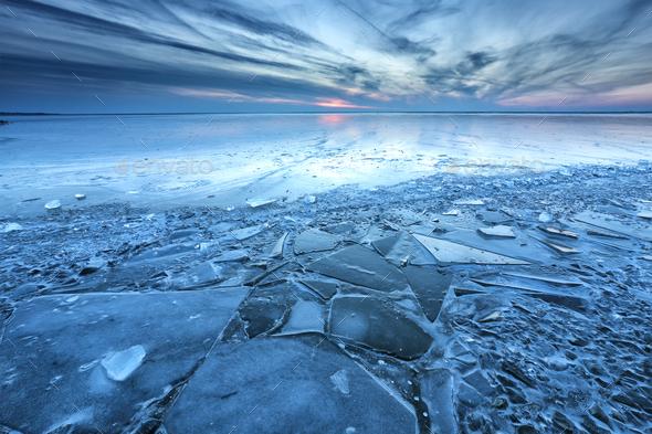 dusk on big frozen lake - Stock Photo - Images