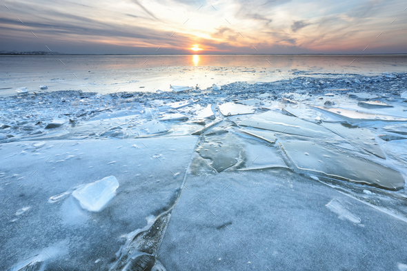 shelf ice on big frozen lake in winter - Stock Photo - Images