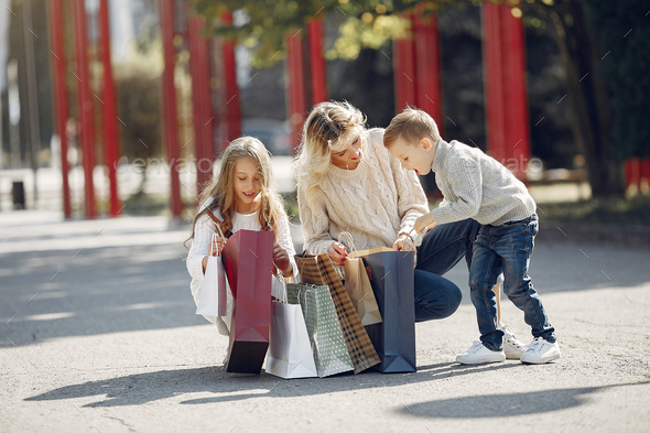 Mother with child with shopping bag in a city - Stock Photo - Images