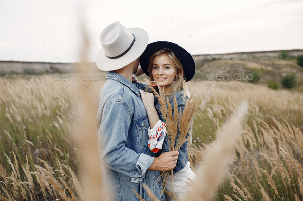 Very beautiful couple in a wheat field - Stock Photo - Images
