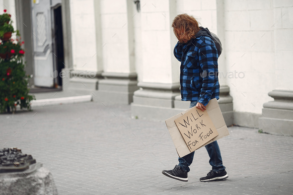 Homeless man in a durty clothes autumn city - Stock Photo - Images