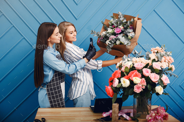Frorist makes a beautiful bouquet in a studio - Stock Photo - Images