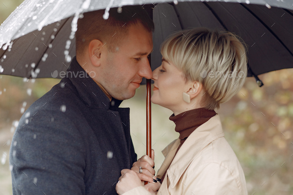 Beautiful couple spend time on a autumn field - Stock Photo - Images