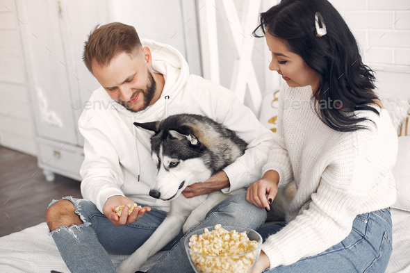 Beautiful couple spend time in a bedroom - Stock Photo - Images
