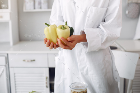 Doctor in a kitchen with a vegetables - Stock Photo - Images