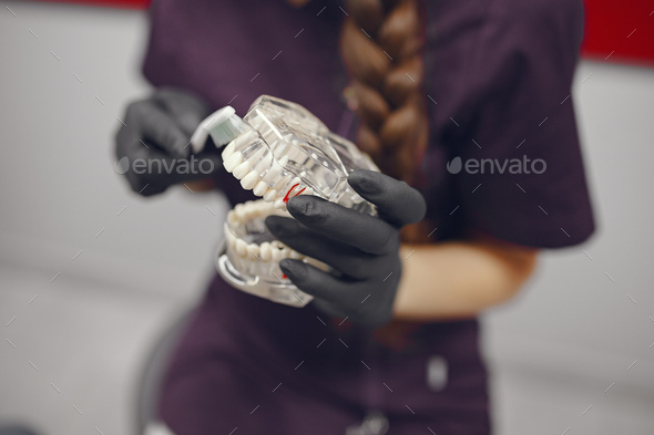 Dental tools in a dentist hand - Stock Photo - Images