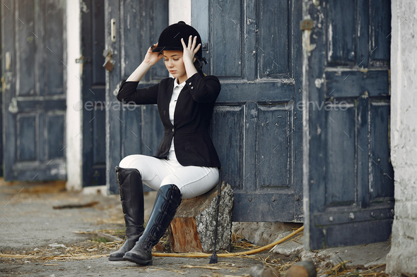 Rider in a sports uniform on a rancho - Stock Photo - Images