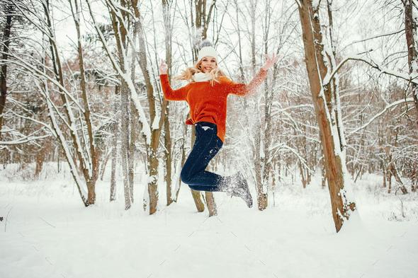 Beautiful girl in a cute orange sweater - Stock Photo - Images