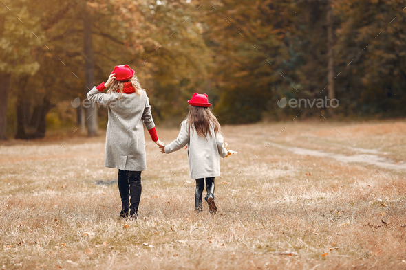 Cute and stylish family in a autumn park - Stock Photo - Images