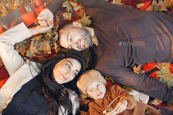 Family with little daughter in a autumn park - Stock Photo - Images
