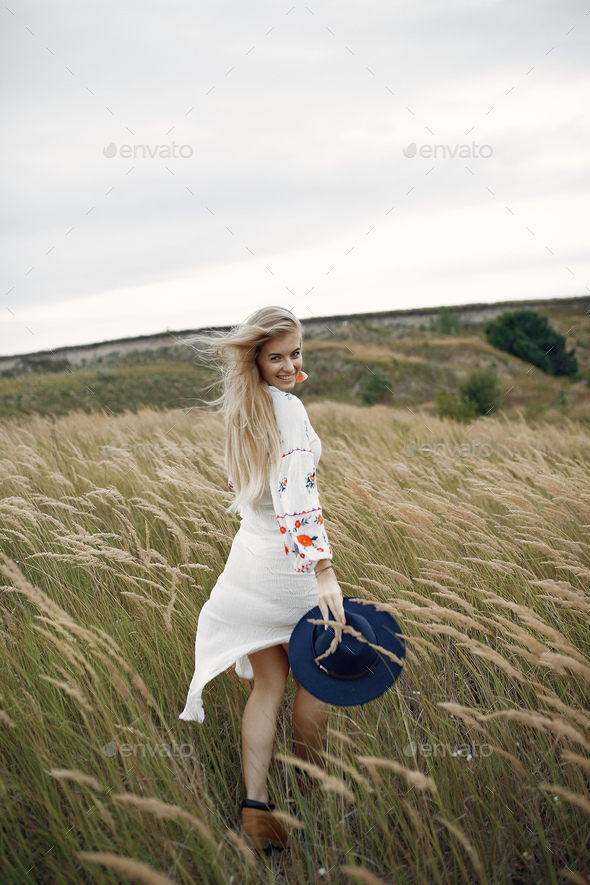 Beautiful elegant girl in a autumn wheat field - Stock Photo - Images