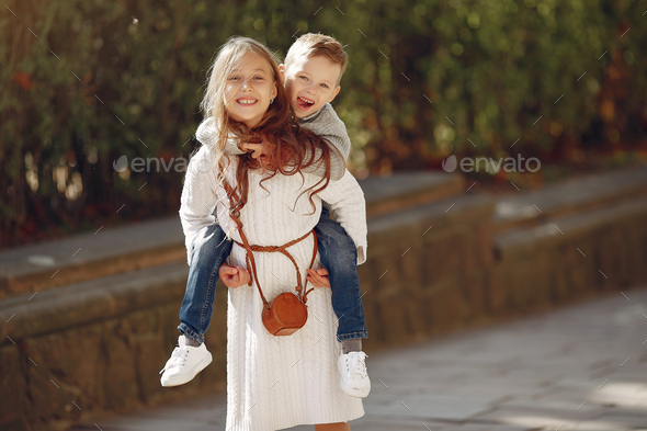 Cute little children with shopping bag in a city - Stock Photo - Images