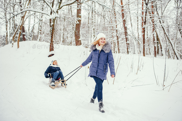 Mother with cute son in a winter oark - Stock Photo - Images