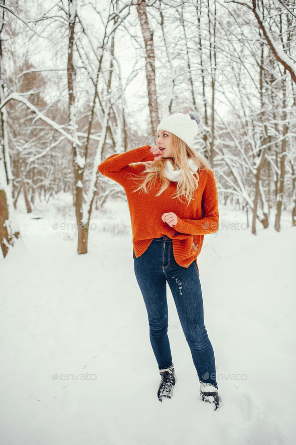 Beautiful girl in a cute orange sweater - Stock Photo - Images