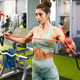Young sportswoman warming up with fitness gums in the gym - PhotoDune Item for Sale