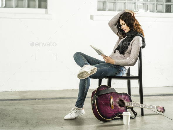 Writing songs with acoustic guitar - Stock Photo - Images