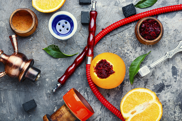 Hookah with orange tobacco. - Stock Photo - Images