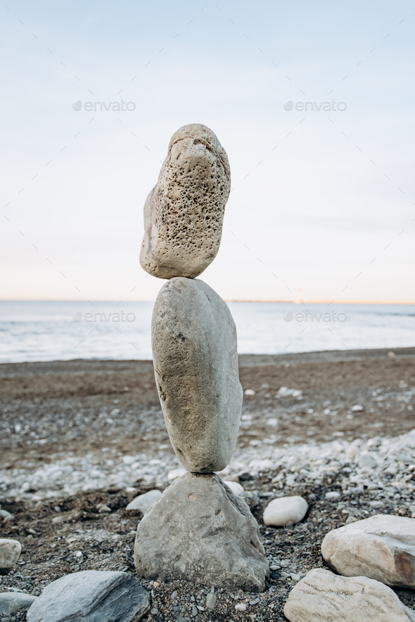 The figure of stones standing on each other, on the beach against the sea. - Stock Photo - Images