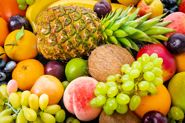 composition with a lot of differrent fruits. exotic fruits - Stock Photo - Images