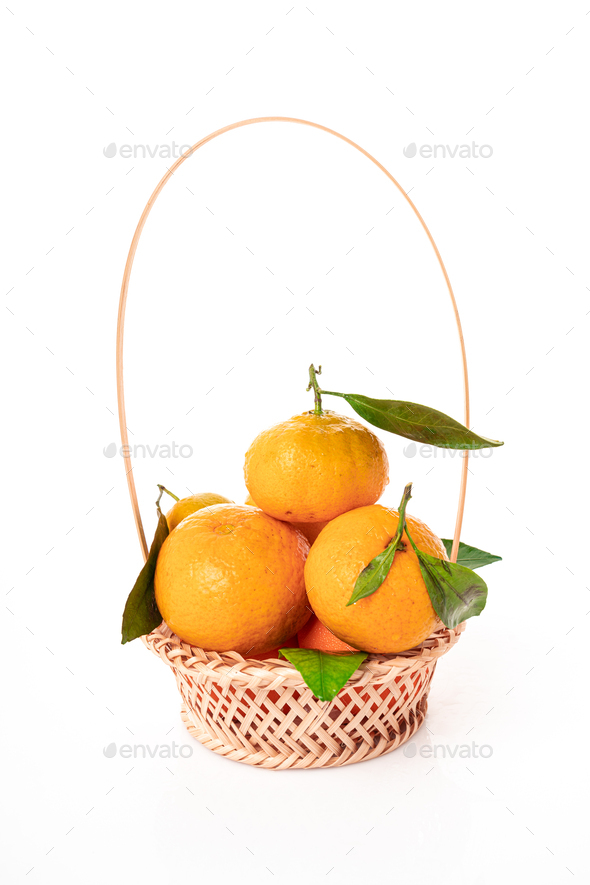 tangerines  with leaves in a beautiful basket. organic ripe mandarins - Stock Photo - Images