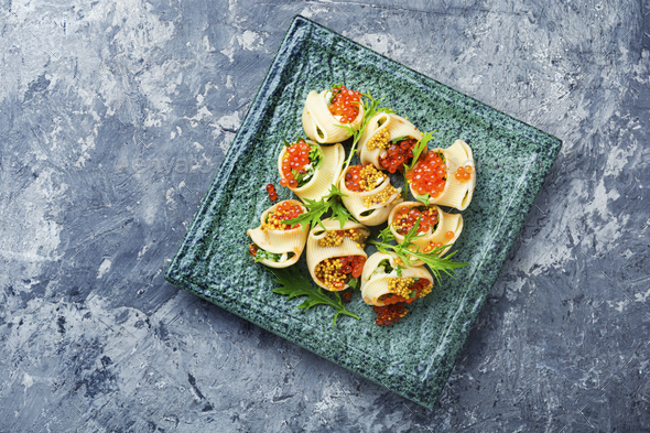 Red caviar stuffed pasta - Stock Photo - Images