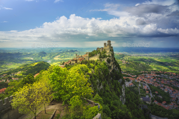 San Marino, medieval tower on a rocky cliff and panoramic view of Romagna - Stock Photo - Images