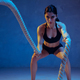 Caucasian young female athlete practicing on blue studio background in neon light - PhotoDune Item for Sale