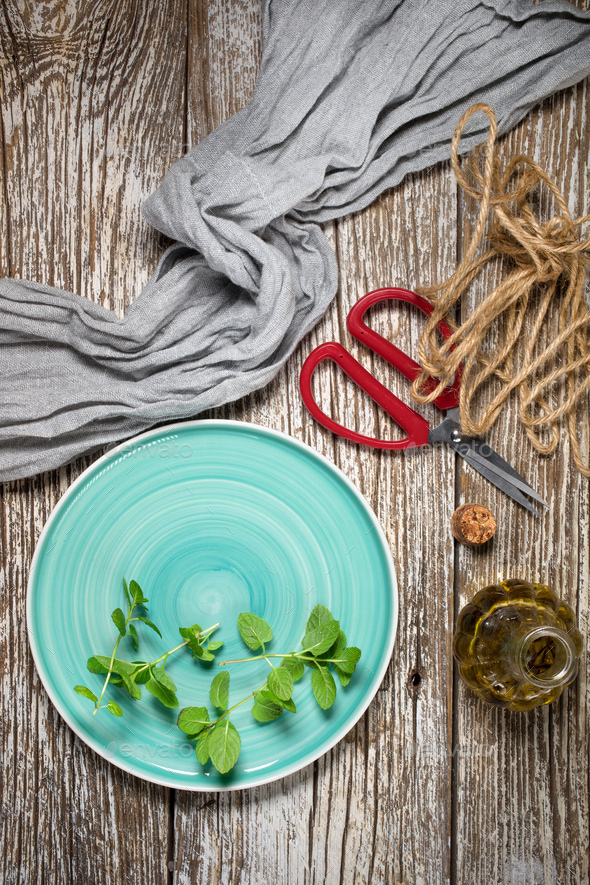 Freshly cut mint leaves on a plate. - Stock Photo - Images