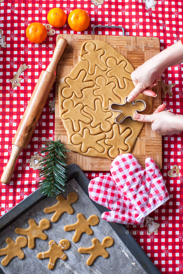 Hands making from dough Christmas gingerbread man - Stock Photo - Images