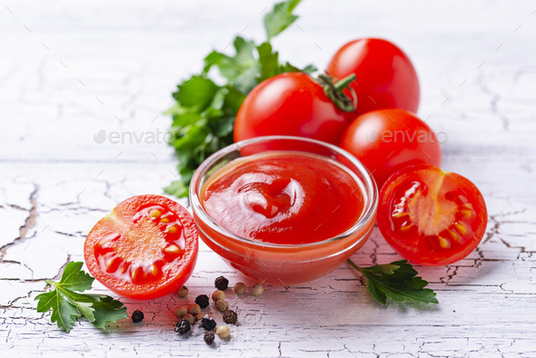 Tomato ketchup sauce on wooden background - Stock Photo - Images