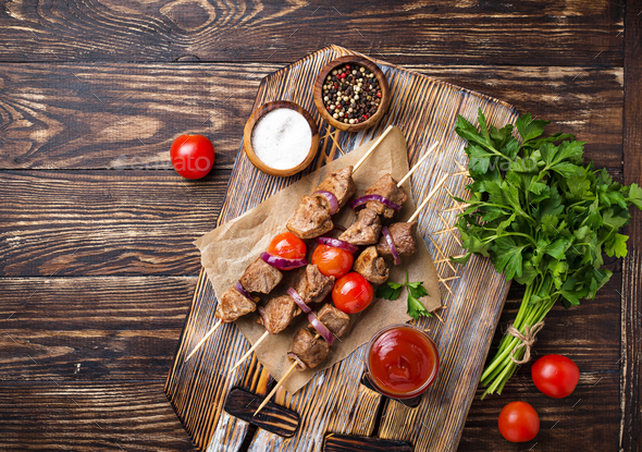 Grilled shish kebab skewers with tomatoes - Stock Photo - Images