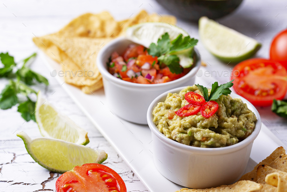 Guacamole, tomato sauce salsa and chips nachos - Stock Photo - Images