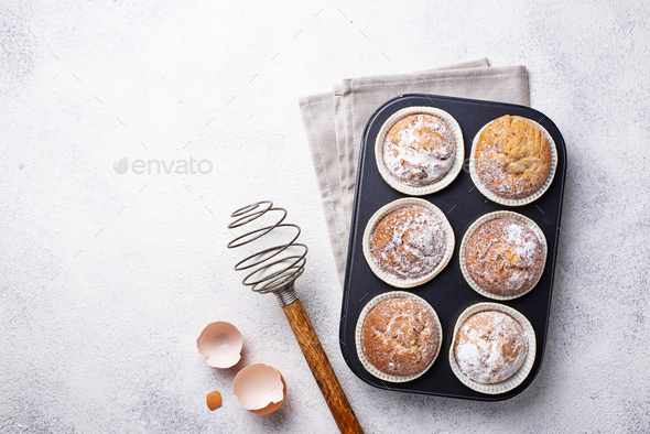 Sweet homemade cupcakes in backing dish - Stock Photo - Images