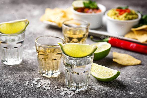 Shots of silver and gold tequila - Stock Photo - Images