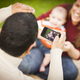 Happy Mixed Race Parents and Baby Boy Taking Self Portraits - PhotoDune Item for Sale