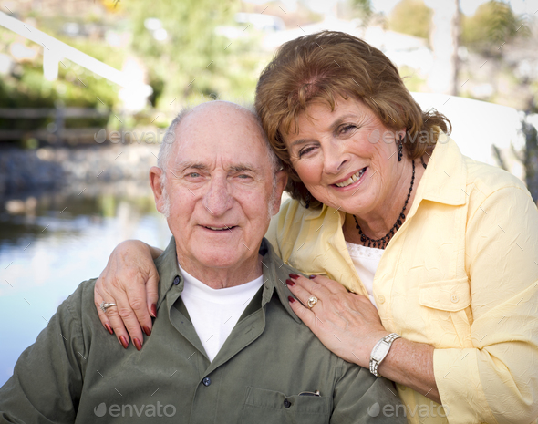 Happy Senior Couple Relaxing in The Park - Stock Photo - Images