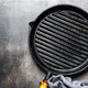 Empty iron grill pan on table - PhotoDune Item for Sale