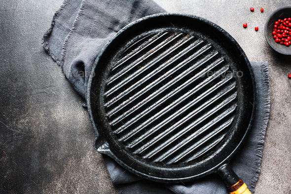 Empty iron grill pan on table - Stock Photo - Images