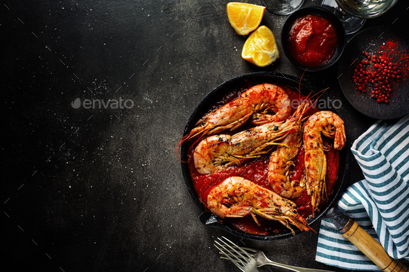 Roasted shrimps on pan on table - Stock Photo - Images