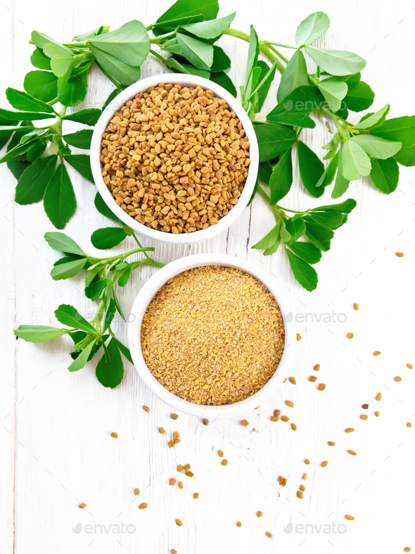 Fenugreek in two bowls with leaves on board top - Stock Photo - Images