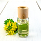 Oil with celandine on light board - PhotoDune Item for Sale