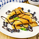 Pancakes with blueberries and chocolate on board - PhotoDune Item for Sale