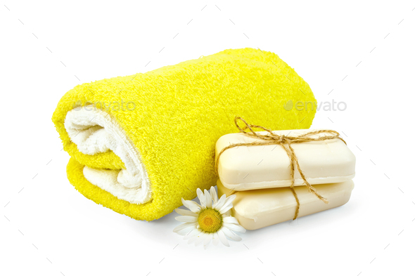 Soap white with chamomile and towels - Stock Photo - Images