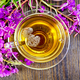 Tea from fireweed in glass cup on board top - PhotoDune Item for Sale