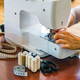 Dressmaker or seamstress works using sewing machine - PhotoDune Item for Sale